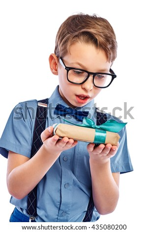 Stylish small boy in glasses received a gift. He surprised. Isolated on a white background. - stock photo