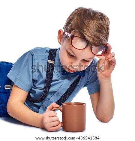 Stylish small boy in glasses watching in the cup. Isolated on a white background. - stock photo