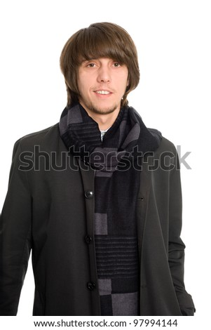 Stylish smiling young man in a raincoat