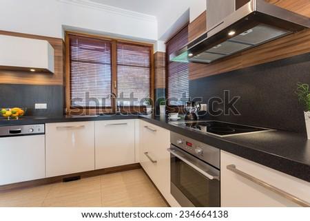 Stylish spacious kitchen in new luxury house - stock photo