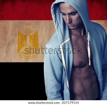 stylish sporty man with Egypt background - stock photo