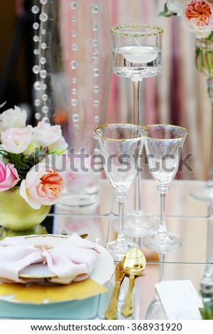 Stylish table set with natural flowers