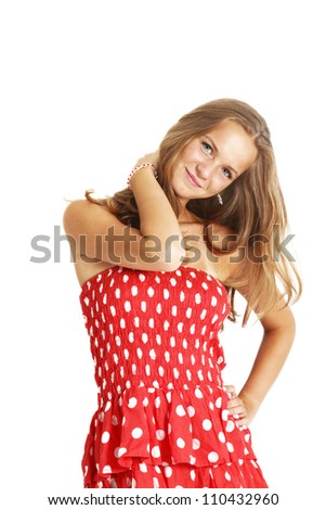Stylish teenage girl Stylish teenage girl in a fashionable red and white polka dot dress standing smiling serenely isolated on white - stock photo