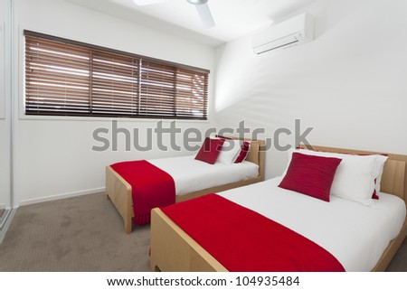 Stylish twin bedroom in modern Australian house - stock photo