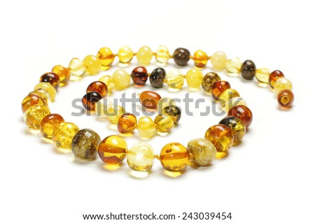 Stylish various colors amber necklace isolated - stock photo