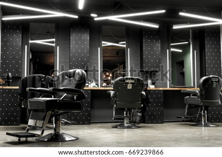 Stylish Vintage Barber Chairs In Black And Grey Interior. Barbershop Theme