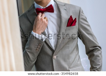 stylish wedding morning cooking groom in a suit - stock photo