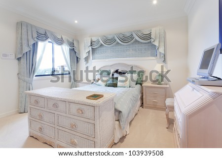 Stylish white bedroom in luxury house - stock photo