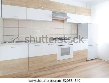Stylish white modern kitchen interior. Toned image.