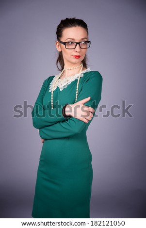 Stylish woman in a green dress