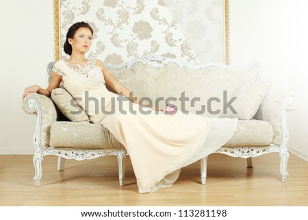 Stylish woman in a luxurious vintage style - stock photo