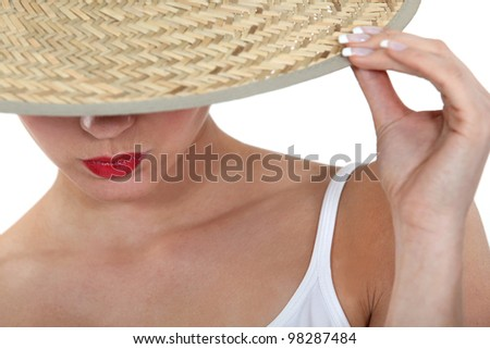 Stylish woman in a straw hat - stock photo