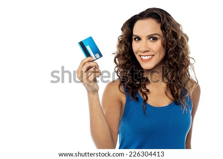 Stylish woman showing her credit card to camera