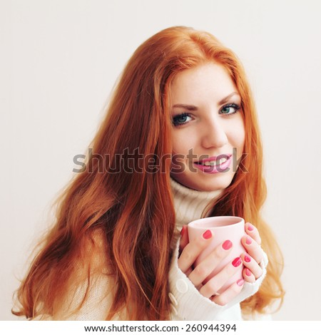 Stylish woman with an aromatic coffee in hands - stock photo