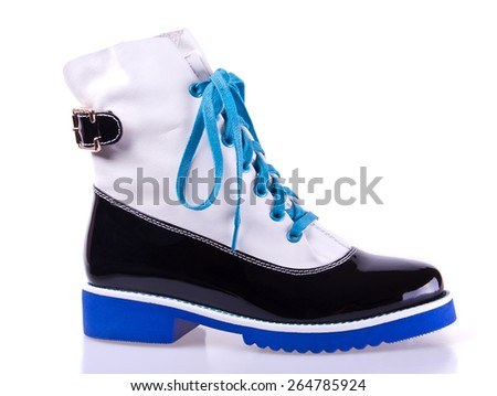 stylish women's black and white shoe with blue laces and sole, isolated on white - stock photo
