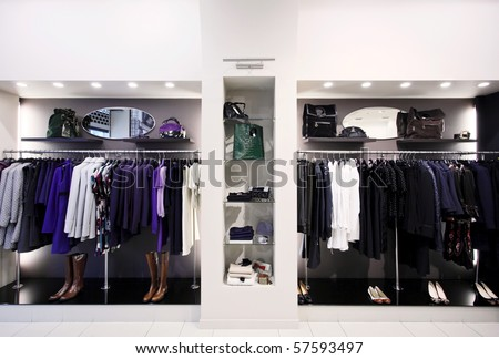 Stylish women's clothes on hangers in shop - stock photo