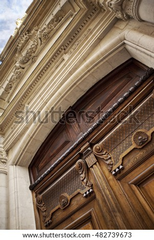 Stylish wooden door of a French mansion in Bordeaux
