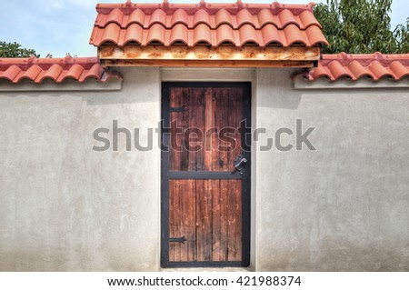 Stylish wooden door with metal ornaments