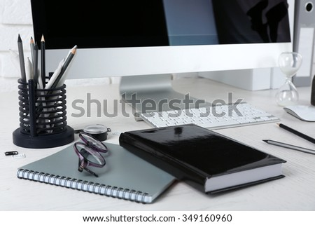 Stylish workplace with computer and stationery
