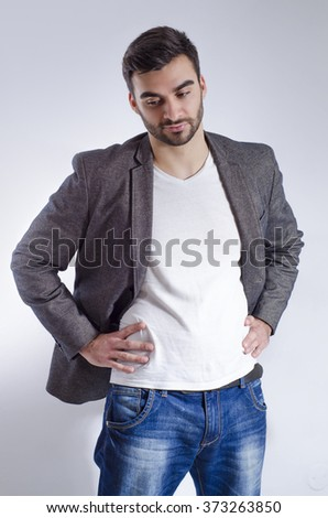Stylish young adult man, wearing jeans white shirt and jacket