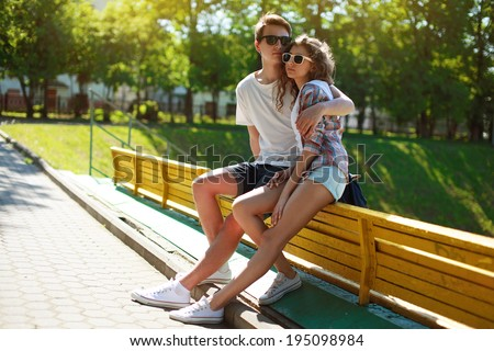 Stylish young couple teenagers in love in the city, summer sunny day - stock photo
