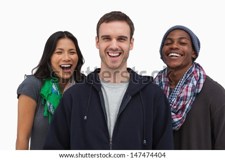 Stylish young friends laughing at camera on white background - stock photo