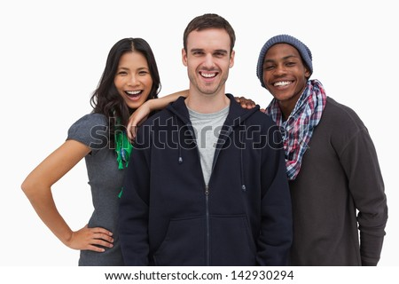 Stylish young friends smiling at camera on white background - stock photo