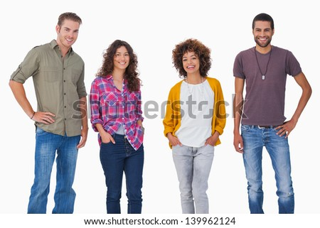 Stylish young friends smiling on white background - stock photo