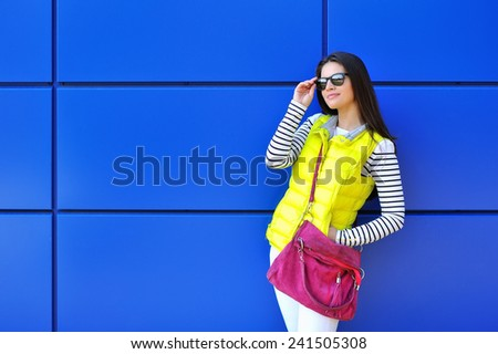 Stylish young girl portrait outdoors - stock photo