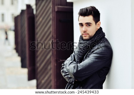 Stylish young handsome man. Outdoor fashion portrait