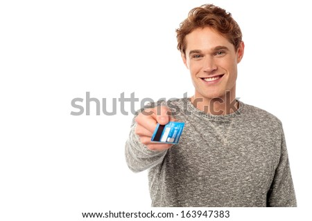 Stylish young man displaying his cash card