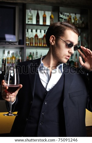 Stylish young man in a bar