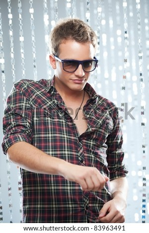 Stylish young man in a night club. - stock photo