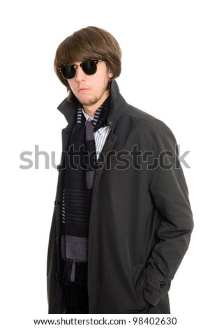 Stylish young man in a raincoat