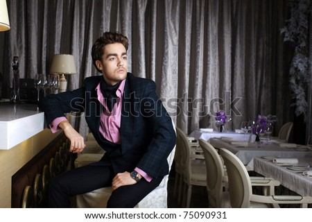 Stylish young man in a restaurant