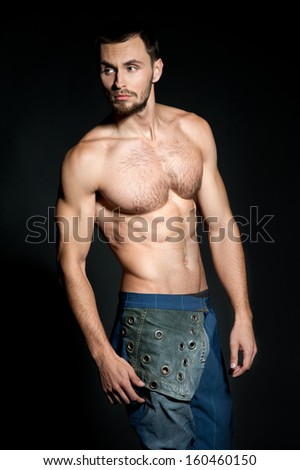 Stylish young man in jeans. Sexy caucasian fit man. Muscular Man