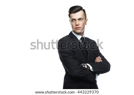 Stylish young man in suit and tie. Business style. Fashionable image. Office worker. Sexy man standing and looking at the camera. Isolated