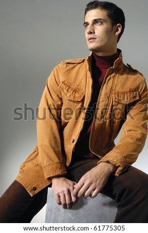 Stylish young man posing and looking at camera isolated - stock photo