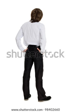 Stylish young man standing with his back looking up - stock photo