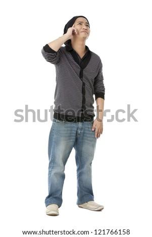 Stylish young man thinking and smiling over white background - stock photo