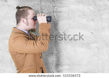 Stylish young man with binoculars
