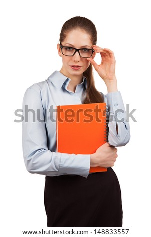 Stylish young woman in glasses with a diary