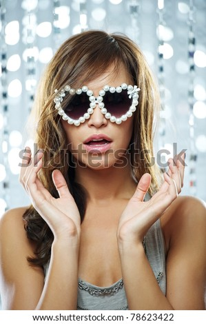 Stylish young woman in sunglasses - stock photo