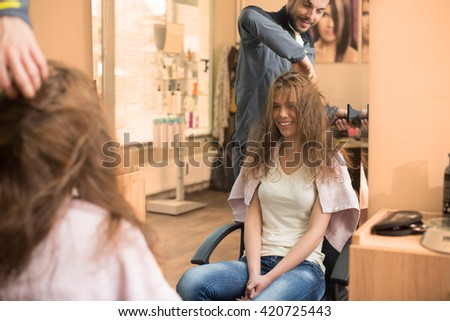 Stylist drying a hair,colored and under exposed photo