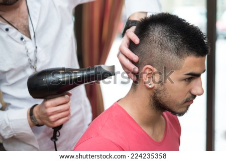 Stylist Drying Hair Of A Male Client - Handsome Man At The Hairdresser Blow Drying His Hair