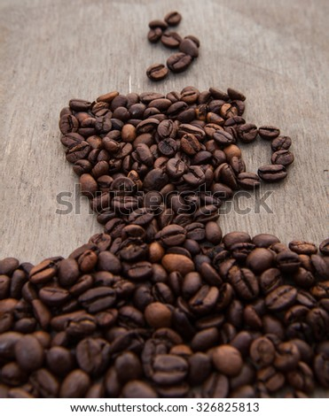 Stylized cup of coffee out of coffee beans
