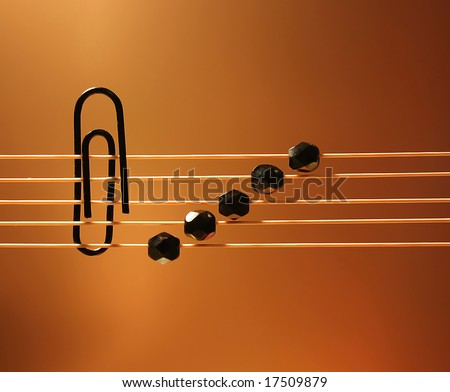 stylized design of musical notation with gold gradient background