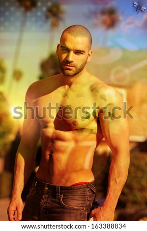 Stylized fashion portrait of a hot shirtless muscular male model with cross processing and overlay retro effects - stock photo