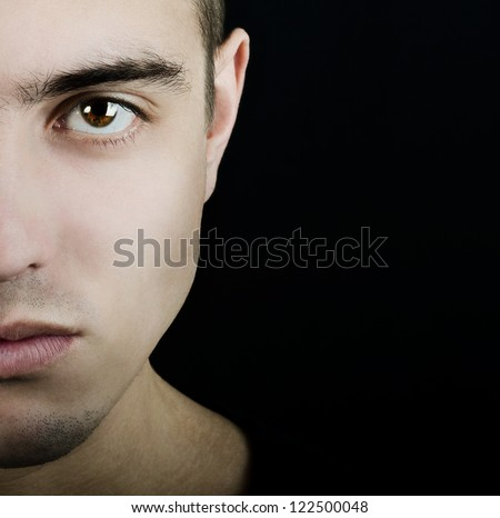 Stylized half face of young man - stock photo
