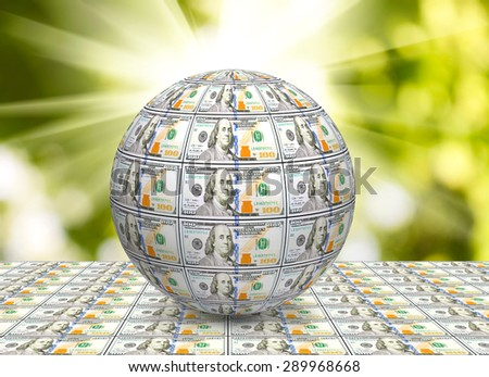 stylized image of the globe made of banknotes on a green background - stock photo